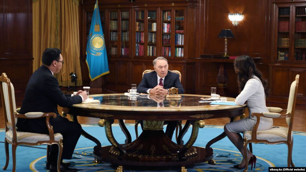 Former Kazakh President Nursultan Nazarbaev (center) made his remarks to interviewers from state TV.