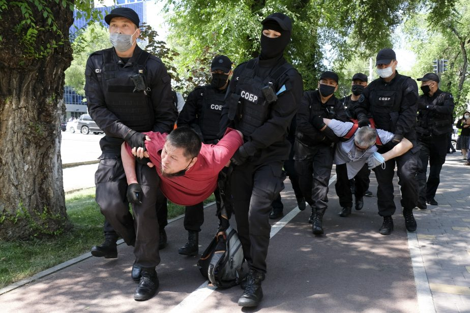 Police wearing face masks to protect against coronavirus, detain protesters during an unsanctioned protest in Almaty, Kazakhstan, Saturday, June 6, 2020.  Credit: AP Photo/Vladimir Tretyakov